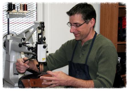 Tom Lenoci Pperforming shoe repair at machine